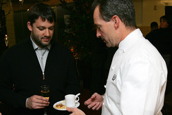 Tony Stewart talks with the John Doherty, head chef at the Waldorf-Astoria, during dinner on Sunday night