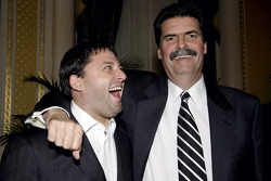 Tony Stewart and NASCAR President Mike Helton share a laugh at dinner