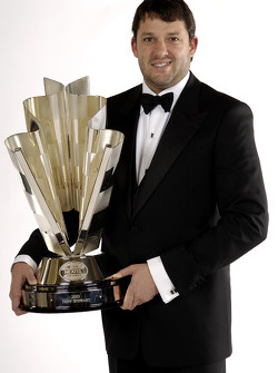 NASCAR Nextel Cup Awards Banquet at the Waldorf Astoria Hotel: Tony Stewart, the 2005 NASCAR Nextel Cup Series Champion, poses with his trophy