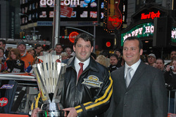 Tony Stewart and crew chief Greg Zipadelli celebrate in Times Square