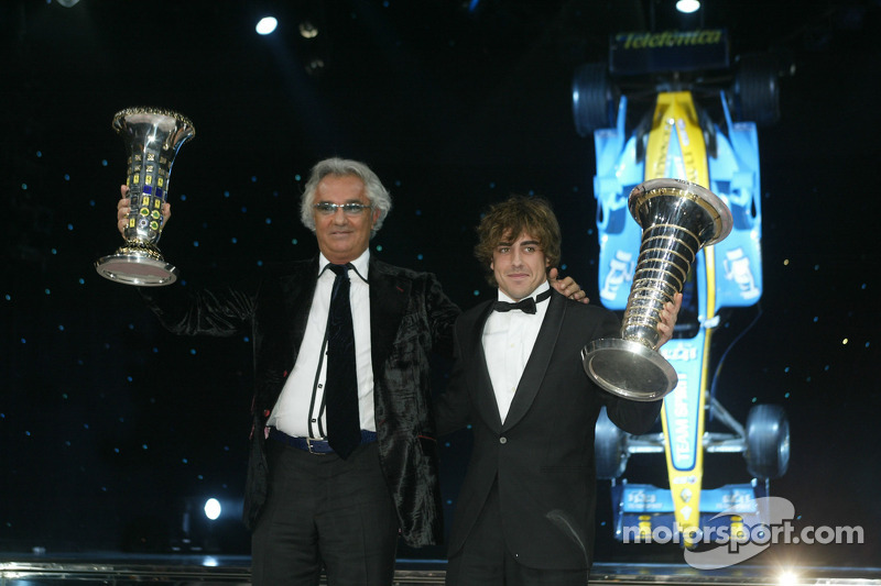 FIA Formula One World Champions Flavio Briatore and Fernando Alonso with the constructors and drivers cups