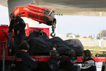 The car of Juan Pablo Montoya is brought back to the pits after stopping on the track