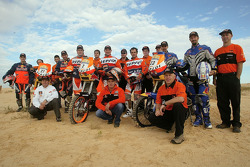 Team Repsol Red Bull KTM: Marc Coma, Carlo de Gavardo, Giovanni Sala, Jordi Duran, Jordi Viladoms, Chris Blais and Andy Grider pose with Repsol KTM team members