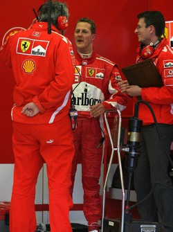 Michael Schumacher back in the pits after his car stopped on the track