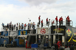Crew members watch test action from atop the transporters