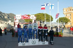Podium: winners Marcus Gronholm and Timo Rautiainen celebrate with Sébastien Loeb and Daniel Elena, and Toni Gardemeister and Jakke Honkanen