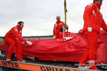 The Ferrari F2004 of Valentino Rossi back after half a lap
