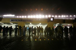 Fans watch tech inspection under the rain