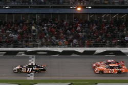 Denny Hamlin take the checkered flag ahead of Dale Earnhardt Jr. and Tony Stewart
