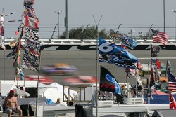 Fans watch cars at speed in turn 3
