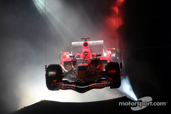 The Scuderia Toro Rosso STR01 flies over the stage during the presentation