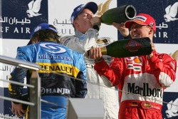 Podium: champagne for Fernando Alonso, Michael Schumacher and Kimi Raikkonen