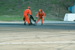 Workers recover the tire carcass from #23 Alex Job Racing