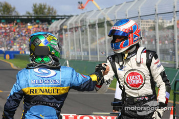Pole winner Jenson Button celebrates with Giancarlo Fisichella
