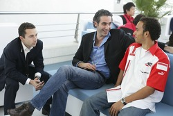 Nicolas Todt and Cedric de la Fontaine talk with Lewis Hamilton