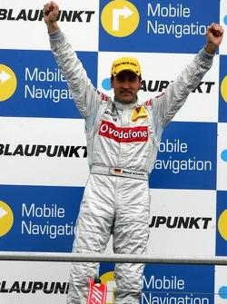 Podium: race winner Bernd Schneider