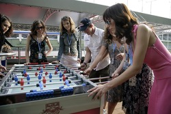 Chilled Thursday: the Formula Unas girls in the Red Bull Energy Station playing tabletop soccer with Scott Speed