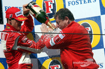 Podium: champagne for Michael Schumacher and Jean Todt