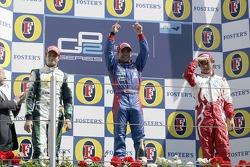 Podium: race winner Ernesto Viso with Nelson A. Piquet and Hiroki Yoshimoto