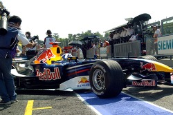 David Coulthard drives out of the garage
