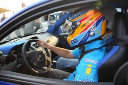 Fernando Alonso takes a fan for a ride around the circuit