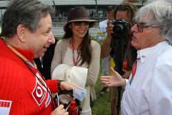Jean Todt hands Bernie Ecclestone 20 Euros