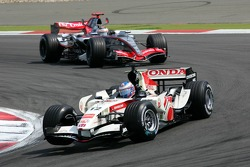 Jenson Button leads Kimi Raikkonen
