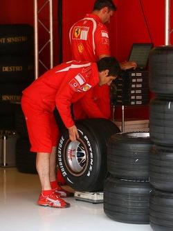 A Ferrari team member with Bridgestone tires