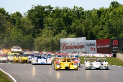 Start: battle for the lead between #6 Penske Motorsports Porsche RS Spyder: Sascha Maassen, Lucas Luhr and #2 Audi Sport North America Audi R8: Rinaldo Capello, Allan McNish