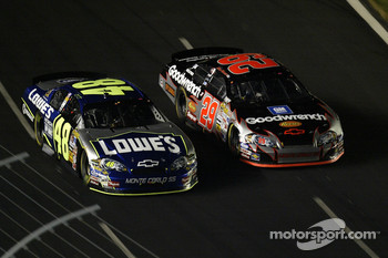 Jimmie Johnson and Kevin Harvick driver of the #29 GM Goodwrench Chevrolet come around a turn during the NASCAR Nextel Cup Series All-Star Challenge