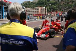 Michelin engineers look on Felipe Massa
