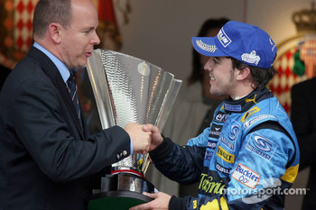 Podium: Race winner Fernando Alonso is congratulated by Prince Albert of Monaco