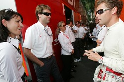Tom Kristensen shares a laugh with Audi Sport Team Joest team members