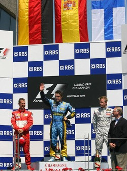 Podium: race winner Fernando Alonso with Michael Schumacher and Kimi Raikkonen