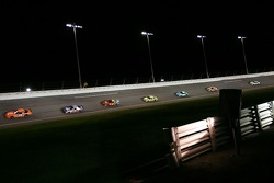 Tony Stewart leads a pack of cars