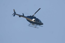 A televison helicopter watches the race
