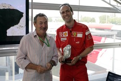 Red Bull chilled Thursday: a Ferrari crew member with a trophy for the Pinewood-Derby