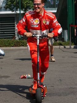 Michael Schumacher on a small step with empty cans hanging behind