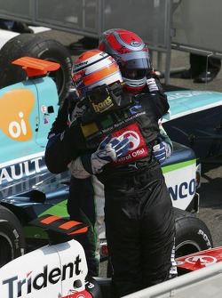 Giorgio Pantano celebrates victory with Nelson A. Piquet