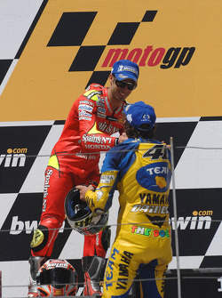 Podium: race winner Valentino Rossi with Marco Melandri