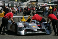 Audi Sport North America crew members push the R10 back to the paddock