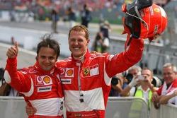 Race winner Michael Schumacher celebrates with Felipe Massa