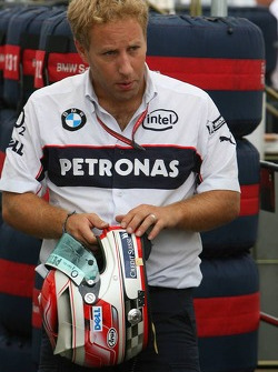 BMW Sauber F1 Team engineer with the helmet of Robert Kubica