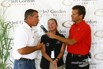 NASCAR TV analyst Jeff Hammond, left, talks with Indianapolis TV sports anchor Dave Calabro, right, as Sarah Fisher looks on