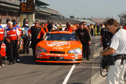 Home Depot Chevy crew members push the car