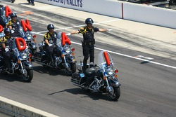 Indianapolis police motorcycle patrolmen perform during pre-race