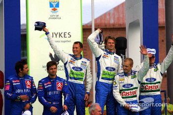Podium: race winners Marcus Gronholm and Timo Rautiainen with second place Sbastien Loeb and Daniel Elena, and third place Mikko Hirvonen and Jarmo Lehtinen