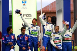 Podium: race winners Marcus Gronholm and Timo Rautiainen with second place Sébastien Loeb and Daniel Elena, and third place Mikko Hirvonen and Jarmo Lehtinen