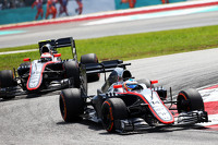 Fernando Alonso, McLaren MP4-30 leads team mate Jenson Button, McLaren MP4-30
