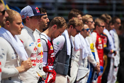 Sebastian Vettel, Ferrari with the drivers as the grid observes the national anthem